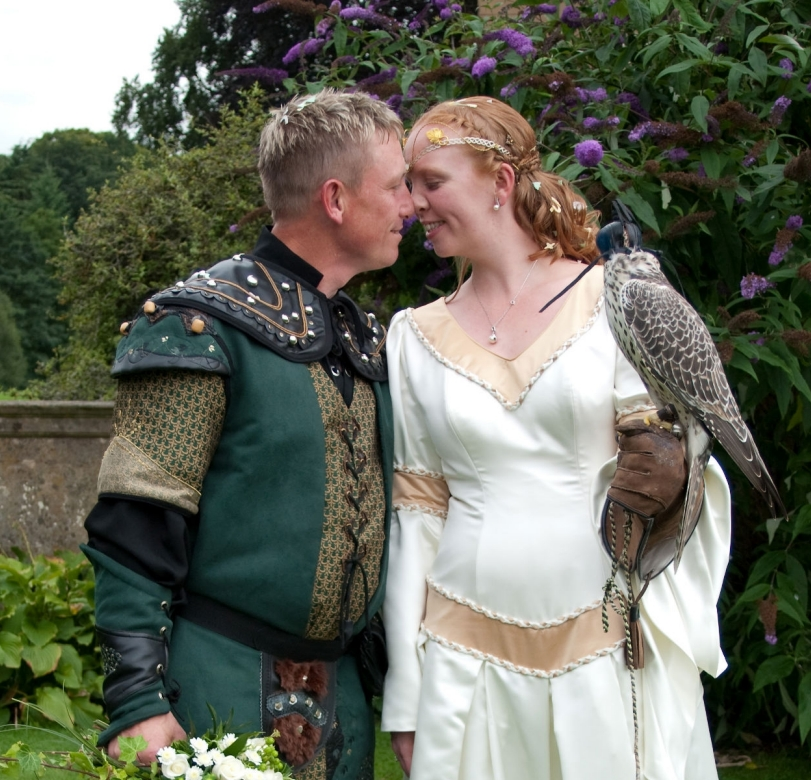 wedding couple medieval costume with falcon